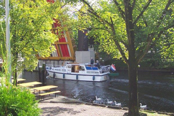 Enjoy a cup of coffee while watching the boats
