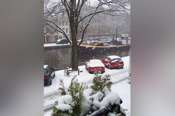 Enjoying the snow in Amsterdam